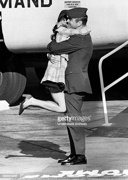 Vietnam POW Air Force Major Hubert Flesher gets a huge hug and a big double leg kick from ihs wife upon his return at Travis Air Force Base to the...