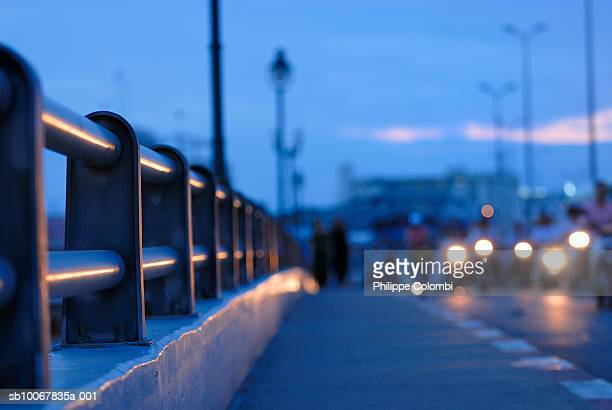 Vietnam, Saigon, Ho Chi Minh, motorcycle headlights on Ong Lanh bridge at dusk