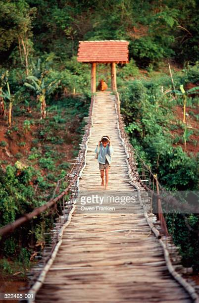 vietnam, son la province, child crossing wood and rope bridge - son la stock pictures, royalty-free photos & images