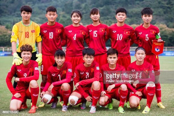 Vietnam squad pose for team photo Doan Thi Ngoc Phuong #19 Tran Thi Hai Linh #4 Ngoc Le #15 Nguyen Thi Hoa #10 Tuyet Ngan #5 Nguyen Thi Minh Anh #2...