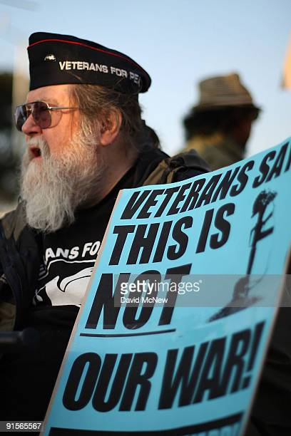 Vietnam veteran Jack Finley joins antiwar demonstrators in calling for a troop pullout in Afghanistan as they rally near the Federal Building eight...