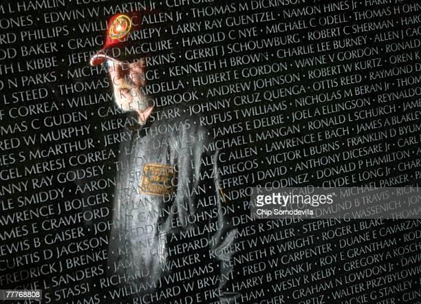 Vietnam veteran Lyle Hurley of Woodbridge Virginia is reflected in the Vietnam Veterans Memorial during ceremonies to mark The Wall's 25th...