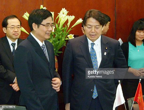 HANOI Vietnam Vietnamese agriculture and rural development minister Cao Duc Phat and Japanese farm minister Yoshimasa Hayashi chat in Hanoi on May 4...