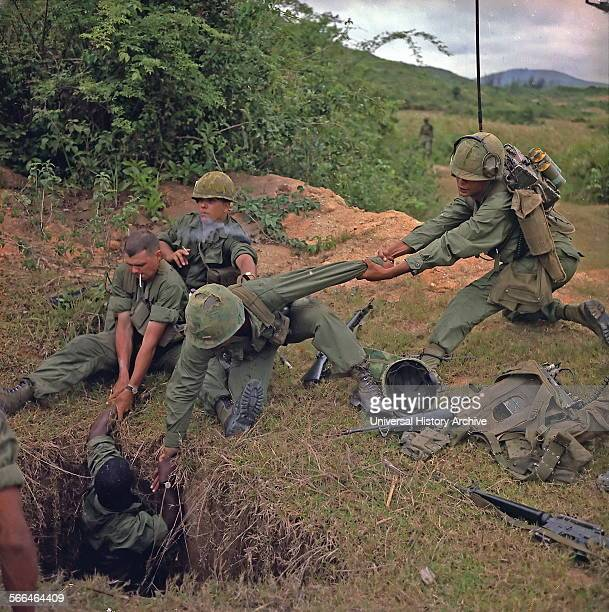 Vietnam War 1968 American soldiers uncover a vietcong tunnel