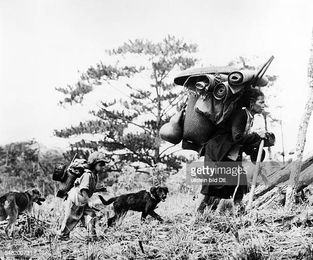 Vietnam War A mother and her son members of the Montagnard hill tribe in South Vietnam fleeing about 1966