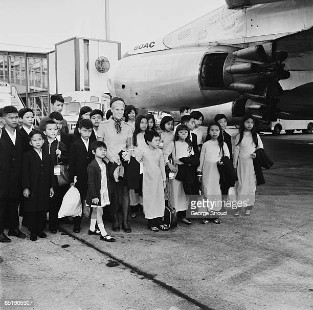 Vietnam war orphans arrive at London Airport, UK, in a precursor to 1975's Operation Babylift, 2nd July 1971.
