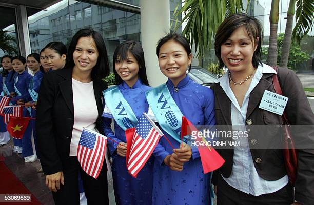 Vietnam War orphans from the 'Babylift Operation' Tiana Mykkeltvedt and Tanya Bakal pose with local students girls in traditional dress 'ao dai'...
