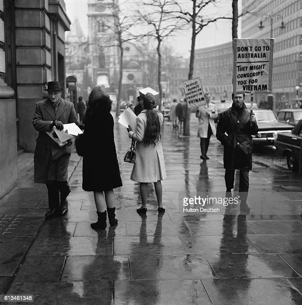 Vietnam War protesters hand out leaflets outside Australia House in London England January 25 1966 Their grievances included the sending of...