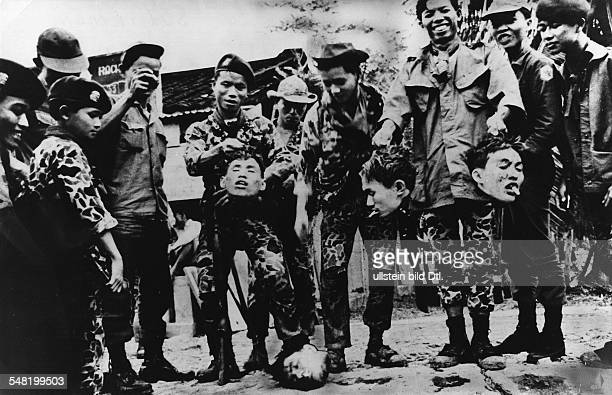 Vietnam War South Vietnamese soldiers posing with the heads of beheaded Vietcong