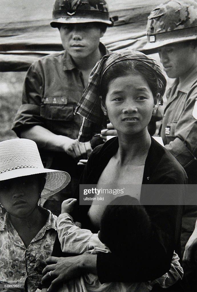 Vietnam war, street scene, soldiers with vietnames mother