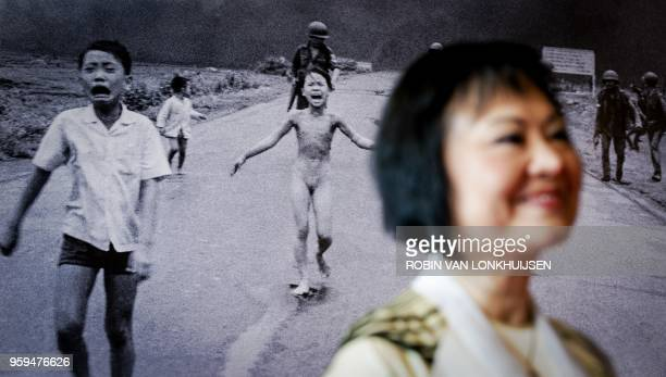 Vietnam war survivor Kim Phuc Phan Thi also known as Napalm Girl stands in front of her iconic 1972 Vietnam War photograph showing her running on a...