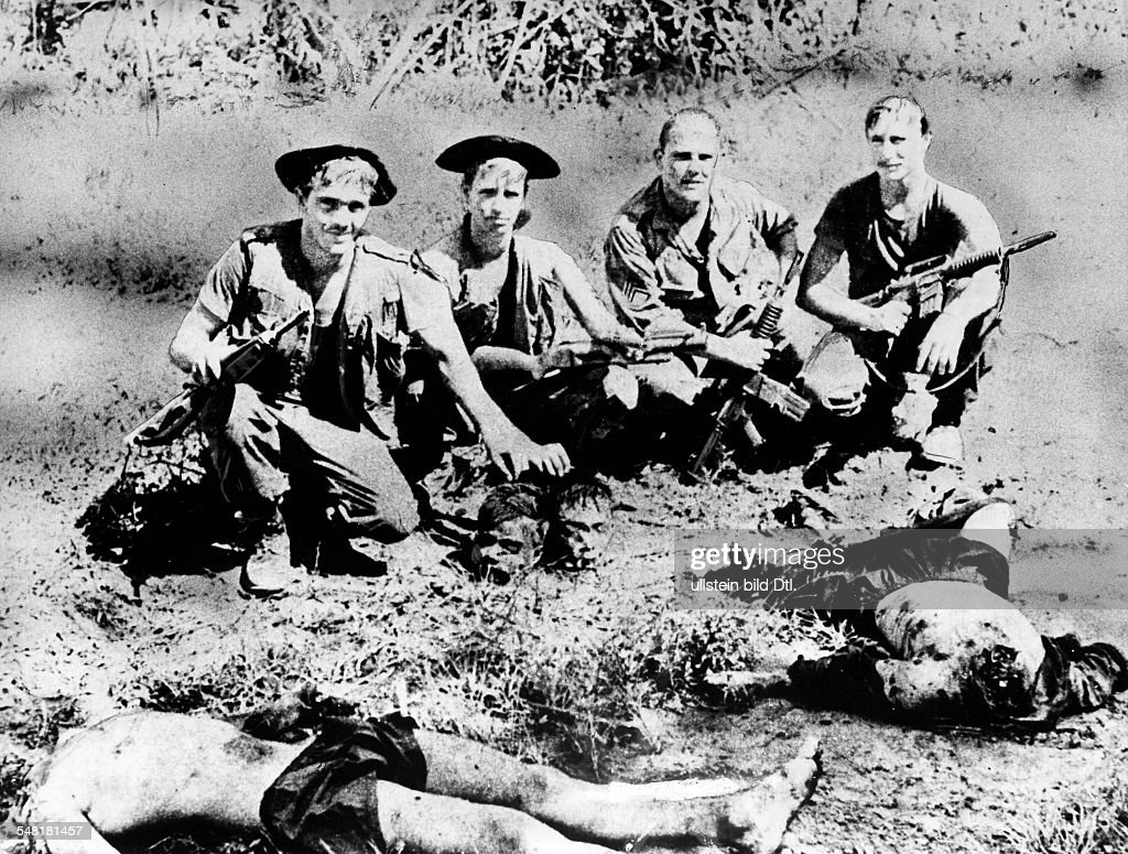 Vietnam war us soldiers posing with the heads of two beheaded vietnam war us soldiers posing with the heads of two beheaded vietcong august 1969 sciox Image collections