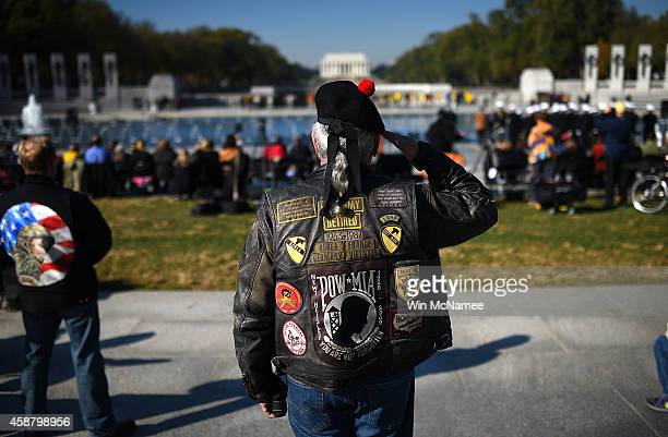 Vietnam war veteran Joe ÒDragonÓ Lozano retired US Army salutes during the playing of ÒTapsÓ at a Veterans Day ceremony at the World War Two Memorial...