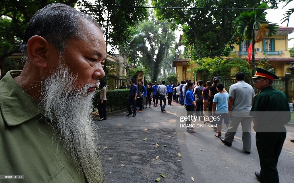 A Vietnam War veteran (L) lines up in the compound of late General Vo Nguyen Giap's residence to pay homage to him, as thousands of people flocked to pay last tribute to the national independence hero in Hanoi on October 6, 2013. Vietnam announced plans to hold a national funeral for independence hero General Vo Nguyen Giap in the first official statement on the death of the ruthless but brilliant military strategist .