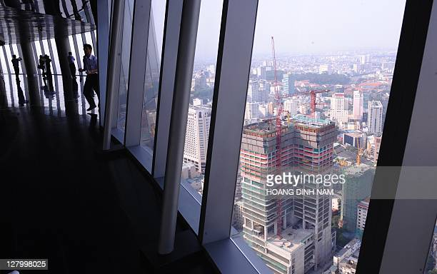 VietnameconomypropertyFEATURE by Ian TIMBERLAKE This picture taken on April 12 2011 shows visitors inspecting Ho Chi Minh city from the 68storey...