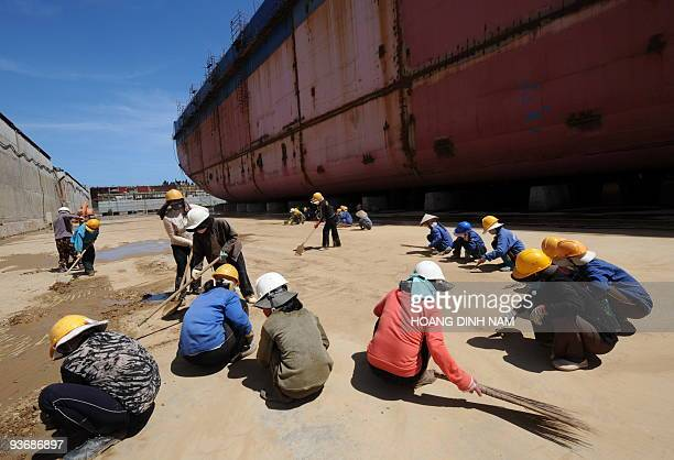 Vietnam-energy-oil-resources-development, by Peter Stebbings Locally hired female workers clean the ground at a ship building factory at Dung Quat...
