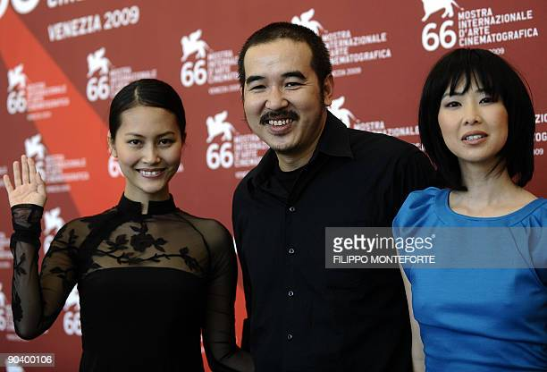 """Vietnamese actress Do Thi Hai, director Bui Thac Chuyen and actress Linh-Dan Pham pose during the photocall of """"Choi Voi"""" at the Venice film festival..."""