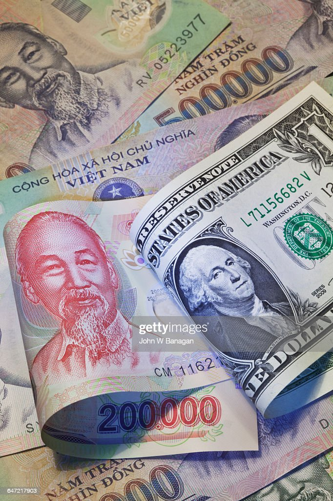 Vietnamese And Us Money Stock Photo