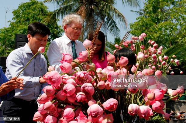Vietnamese and US representatives pay their respects at a war memorial dedicated to the victims of the My Lai massacre at the village of Son My in...
