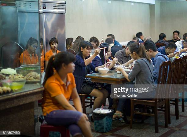 Vietnamese are eating in a snack bar in Hanoi on October 30 2016 in Hanoi Vietnam