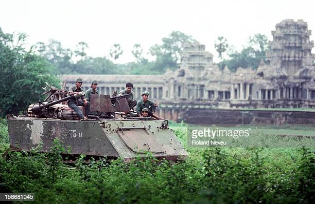 Vietnamese army tank rolling past Angkor Wat during their pullout from Cambodia
