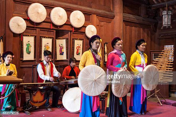 vietnamese band playing a traditional instruments - traditional musician stock photos and pictures