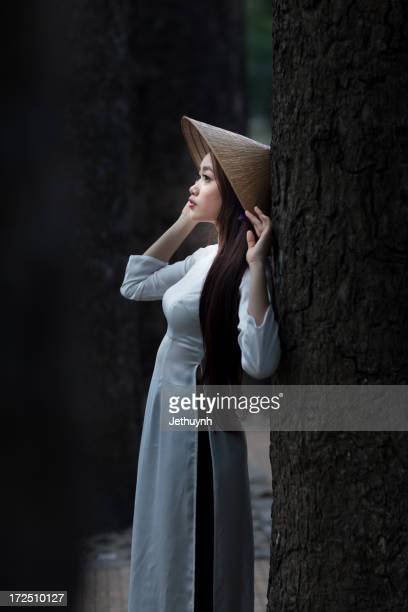 Vietnamese Beautiful girl with Ao Dai and Leaf Hat
