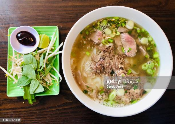 vietnamese beef pho - sergio amiti stock pictures, royalty-free photos & images