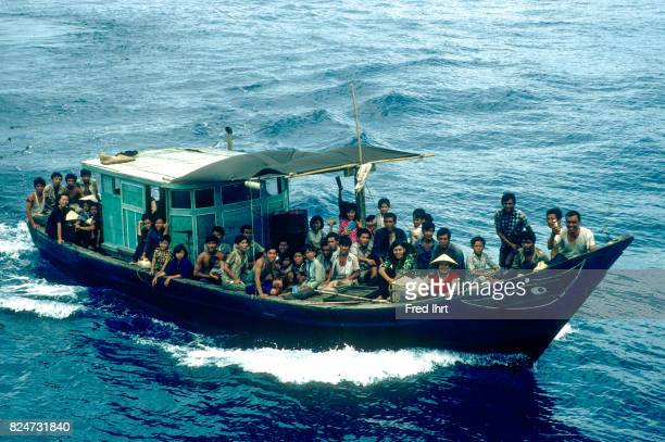 Vietnamese boat people on their nautical vessel approach rescue ship The number of boat people leaving Vietnam and arriving safely in another country...