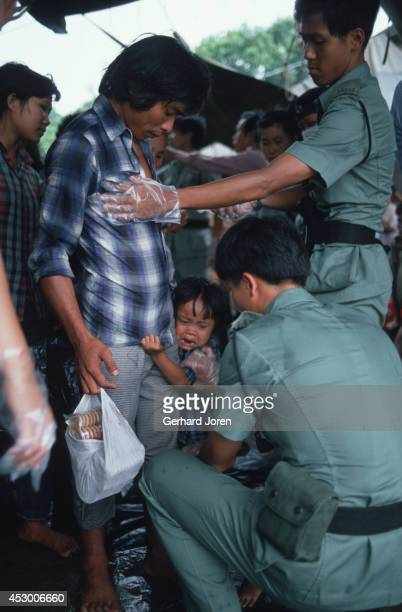 Vietnamese boat refugees beeing screened up on arrival in Hong Kong. More than 200,000 Vietnamese refugees arrived by boat in Hong Kong during the...