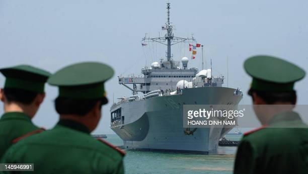 Vietnamese border guards watch the US Seventh Fleet's USS Blue Ridge entering Tien Sa port as Vietnam welcomes the port call of three US naval ships...