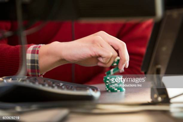 vietnamese businessman with poker chips at office desk - gambling stock pictures, royalty-free photos & images