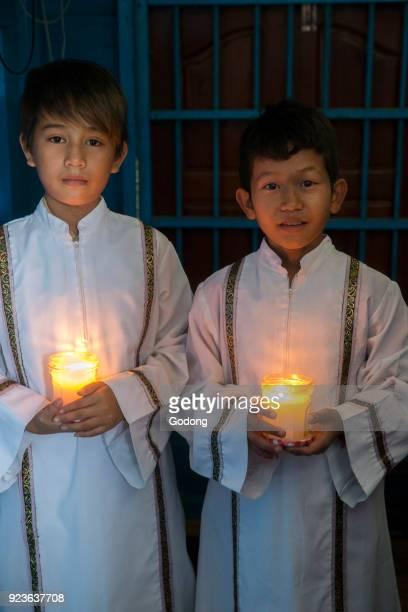 Vietnamese Catholic altar boys in Chong Khnies church Cambodia