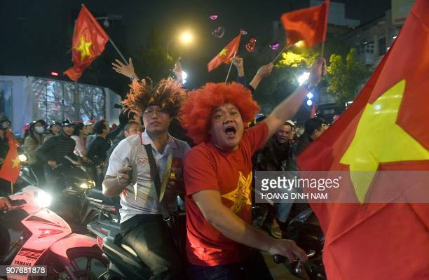 Vietnamese celebrate in downtown Hanoi after their team defeated Iraq for Asian AFC U23 Championship football match being hosted in China on January...