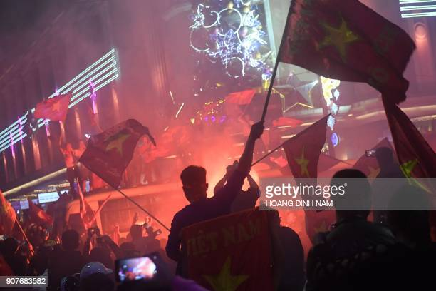 Vietnamese celebrate in downtown Hanoi after their team defeated Iraq during the Asian AFC U23 Championship football match being hosted in China on...