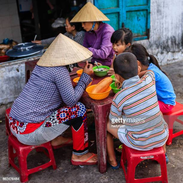 vietnamese children eating a pho bo, south vietnam - pho soup stock pictures, royalty-free photos & images