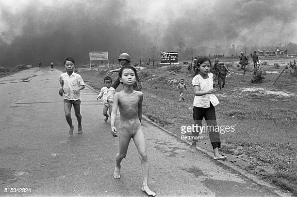 Vietnamese children flee from their homes in the South Vietnamese village of Trang Bang after South Vietnamese planes accidently dropped a napalm...