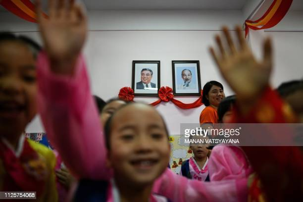Vietnamese children play in front of the portraits of the late leaders of North Korea Kim Il Sung and Vietnam's Ho Chi Minh at the VietnamNorth Korea...