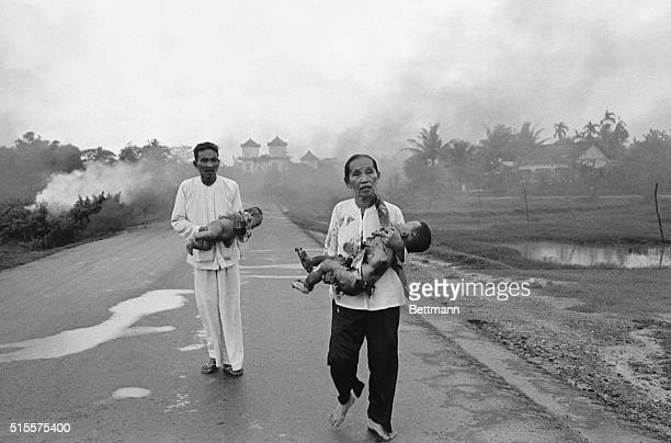 Vietnamese civilians run when their village is accidentally bombed with napalm