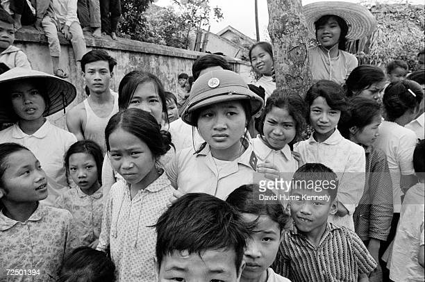 Vietnamese civilians watch the release of American POW's from the Hanoi Hilton March 291973 in Hanoi Vietnam