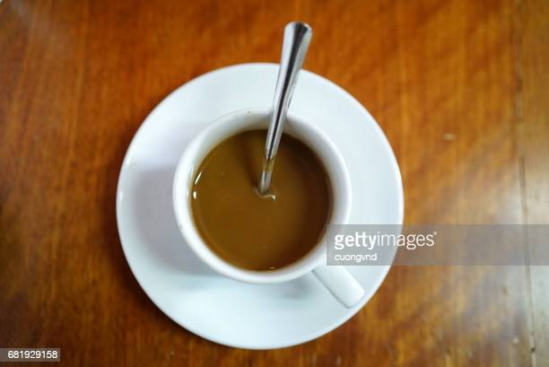 Vietnamese coffee with condensed milk cafe sua da on a wooden background