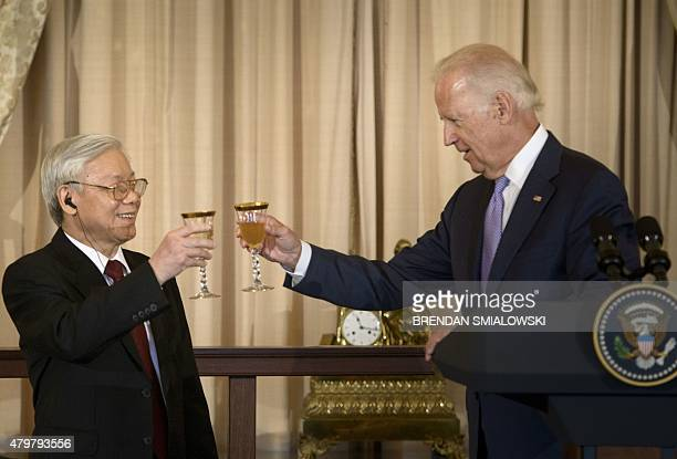 Vietnamese Communist Party General Secretary Nguyen Phu Trong toasts before a luncheon with US Vice President Joe Biden at the US State Department on...