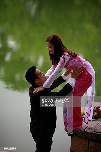 Vietnamese couple having their photos taken in preparation for their wedding In Vietnam today the marriage age may range from 18 to 22 for women and...