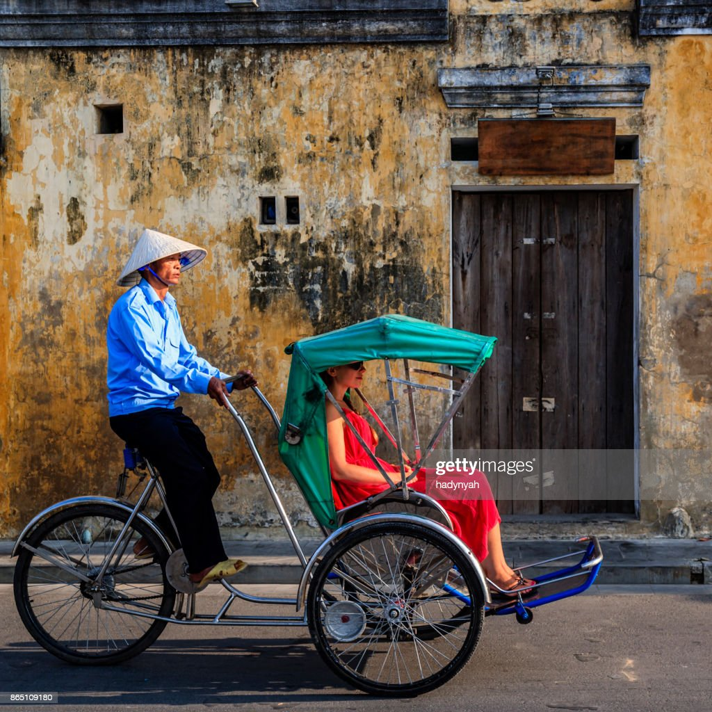 Vietnamese cycle rickshaw in old town in Hoi An city, Vietnam : Stock Photo