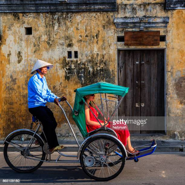 vietnamese cycle rickshaw in old town in hoi an city, vietnam - traditionally vietnamese stock pictures, royalty-free photos & images