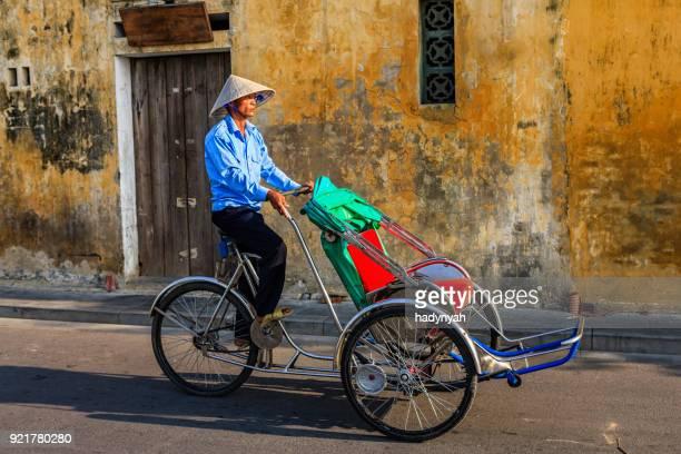Vietnamese cycle rickshaw in old town in Hoi An city, Vietnam