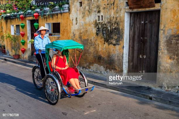 vietnamese cycle rickshaw in old town in hoi an city, vietnam - vietnam stock pictures, royalty-free photos & images
