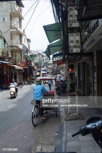 A Vietnamese cyclo driver waits for a fare