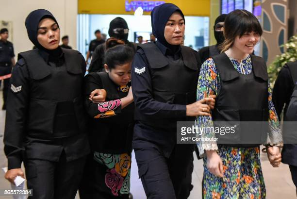 TOPSHOT Vietnamese defendant Doan Thi Huong and Indonesian defendant Siti Aishah are escorted by police personnel at the lowcost carrier Kuala Lumpur...