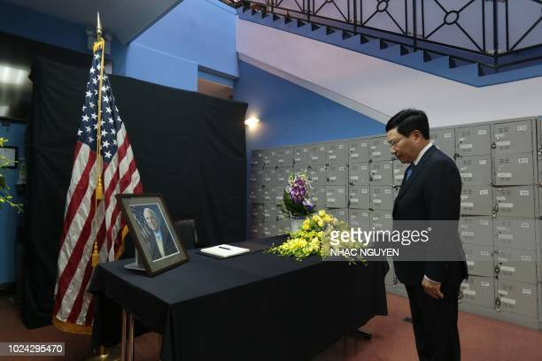 Vietnamese Deputy Prime Minister Pham Binh Minh pays repect to the late US Senator John McCain during a memorial tribute at the US embassy in Hanoi...